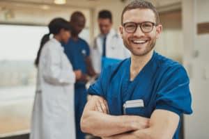 Happy optimistic young hospital surgeon